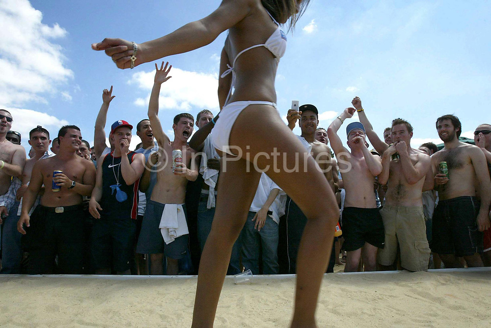 One of the contestants in the bikini contest is cheered by a crowd of young men at St Georges Park Wandsworth, South West London, as part of the Sanex Urban Beach Party.