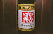 A bottle of Dragon Seal 2002 Cabernet Sauvignon red wine with, on the label, the name of the winery in old-style Chinese characters Beijing, China, Asia
