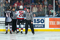 KELOWNA, BC - JANUARY 4:  Alex Kannok Leipert #41 of the Vancouver Giants and Matthew Wedman #20 of the Kelowna Rockets stand at the timekeepers box speaking to referee Chris Crich after several penalties land players of both teams in the penalty box at Prospera Place on January 4, 2020 in Kelowna, Canada. (Photo by Marissa Baecker/Shoot the Breeze)