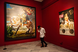 © Licensed to London News Pictures. 27/06/2018. London, UK. Painting titled Equestrian Portrait of King Philip II (Michael Jackson) (L) by Kehinde Wiley, 2010, and artwork titled Black Ebony II, 2010, by artist Lyle Ashton Harris is shown as part of the Michael Jackson: On the Wall exhibition at the National Portrait Gallery. Photo credit: Ray Tang/LNP