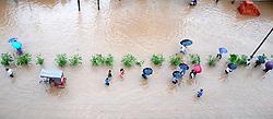 June 12, 2017 - Guwahati, India - People wades through water logged RGB Road in Guwahati the capital city of North-East India, after a heavy shower. (Credit Image: © Rajib Jyoti Sarma/Pacific Press via ZUMA Wire)