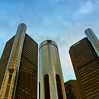 """""""RenCen in Gold""""<br /> <br /> The beautiful GM Renaissance Center in Detroit with late day sunlight casting a golden tone on the buildings.<br /> <br /> Cities and Skyscrapers by Rachel Cohen"""
