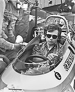 French Matra driver, Jean Pierre Beltoise, during indicates to mechanics before the training session of the 1969 Spanish Grand Prix at the Montjuïc urban circuit in Barcelona, Spain.