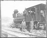 """RGS 2-8-0 #19 with crewmen.<br /> RGS  Telluride, CO  Taken by O'Hanlon, Herbert - 1906<br /> In book """"RGS Story, The Vol. X: Over the Bridges? Ridgway to Durango"""" page 221<br /> See RD155-094 for enlargement.<br /> Also in """"Silver San Juan"""", p. 157; """"Narrow Gauge Country"""", p. 188 and """"The Rio Grande Southern Railroad"""" promo, p. 14."""