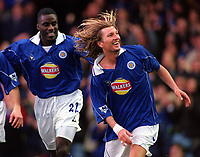 Robbie Savage celebrates scoring a goal for Leicester with team mate Ade Akinbiyi. Leicester City v Leeds United. FA Premiership, 2/12/00. Credit: Colorsport / Nick Kidd.