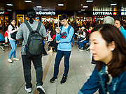 SEOUL, SOUTH KOREA: A passenger waiting on a train checks his smart phone at Seoul Station, the largest train station in South Korea.    PHOTO BY JACK KURTZ