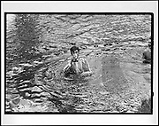Julian Alison drinking in the river. May morning Oxford.1 May 1983. Film 83234f17