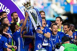 Willian and David Luiz lift the trophy high as Chelsea celebrate winning the 2016/17 Premier League - Rogan Thomson/JMP - 21/05/2017 - FOOTBALL - Stamford Bridge - London, England - Chelsea v Sunderland - Premier League..