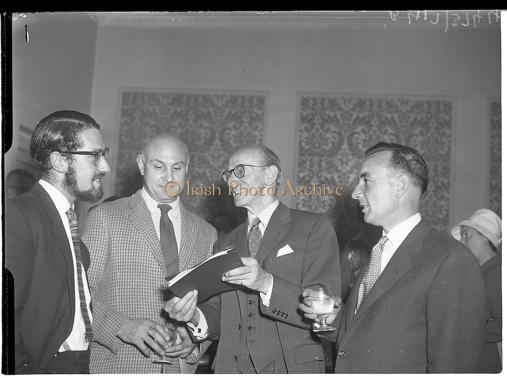 "30/05/1960<br /> 05/30/1960<br /> 30 May 1960<br /> W.D. & H.O. Wills and Gael Linn press conference on new collaboration at the Hibernian Hotel Dublin. Image shows (l-r): Louis Marcus, Film Director; Peter Hunt, Recording Engineer; A. Price, Advertising Manager, W.D. & H.O. Wills. Film concerned most likely ""Peil""."