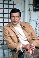 Actor Roger Moore at his home near Denham, Buckinghamshire, England in 1977. Moore played the roles of James Bond and The Saint and many more. Photographed by Terry Fincher.