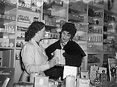 1954,  01/12/1954,  Mr Eamon Andrews and Alma Cogan at Woulfes Pharmacy, Grafton St.