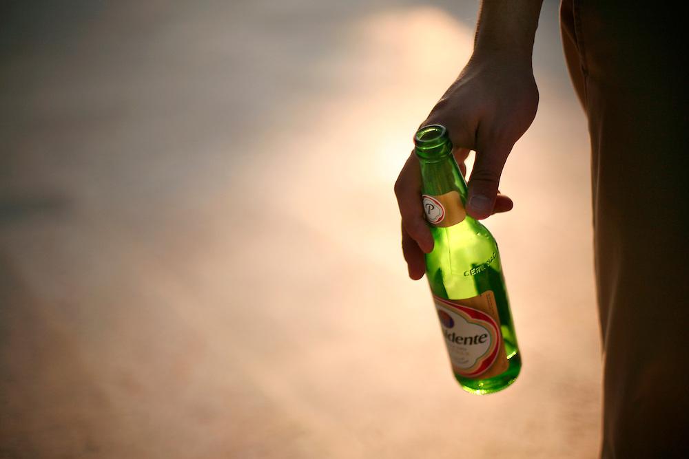 Cap Cana, Dominican Republic - April 12: A man drinks El Presidente beer in Cap Cana, Dominican Republic, April 12, 2007.
