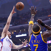21 April 2014: Los Angeles Clippers forward Blake Griffin (32) goes for the skyhook over Golden State Warriors center Jermaine O'Neal (7) during the Los Angeles Clippers 138-98 victory over the Golden State Warriors, during Game Two of the Western Conference Quarterfinals of the NBA Playoffs, at the Staples Center, Los Angeles, California, USA.