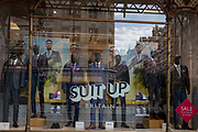 A menswear shop window with fashion mannequins and the words Suit-up Britain, on the Strand on 1st September 2017, in London, England.