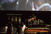 Brooklyn, NY - 20 January 2015. The dress rehearsal of Sufjan Stevens' Round-Up, with slow motion film of the Pendleton, Oregon Round-Up by Aaron and Alex Craig, music performd by Sufjan Stevens and Yarn/Wire. Ning Yu on piano, Russell Greeenberg bowing the vibraphone.