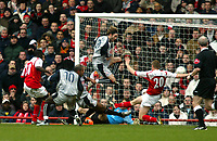 Photo. Chris Ratcliffe<br /> Arsenal v Stoke City. FA Cup Third Round. <br /> 09/01/2005<br /> Wayne Thomas celebrates his opening strike as his fellow players try to catch up.
