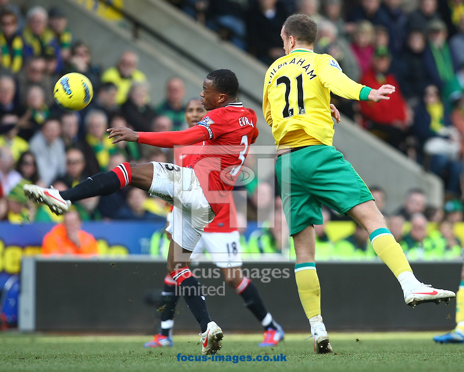 Picture by Paul Chesterton/Focus Images Ltd.  07904 640267.26/02/12.Patrice Evra of Man Utd and Aaron Wilbraham of Norwich in action during the Barclays Premier League match at Carrow Road Stadium, Norwich.