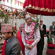 The groom leaves his home to walk to the bride's family in a parade called Janti.