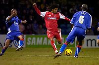 Photo: Alan Crowhurst.<br />Gillingham v Swindon Town. Coca Cola League 1. 14/01/2006. <br />Swindon's Ashan Holgate (C) shoots at goal.