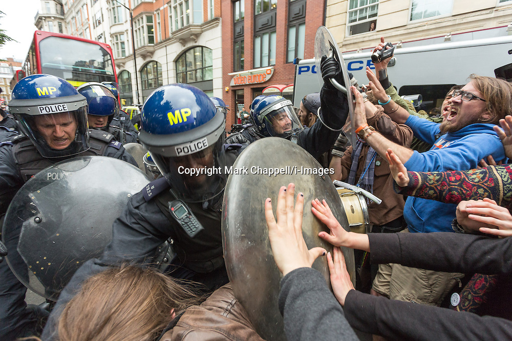 Police and protestors clash in Golden Square, Soho, during the J11 protest in central London by the StopG8 anti-capitalist movement.  Tuesday 11  June  2013.  London, UK.<br /> Photo by: Mark Chappell/i-Images