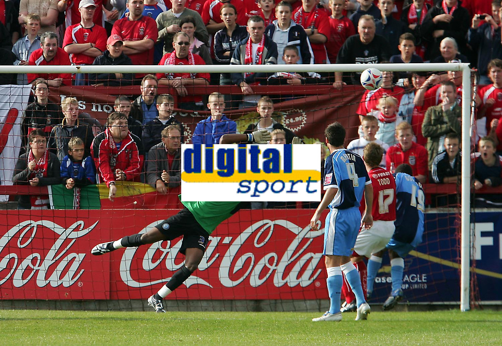 Photo: Andrew Unwin.<br />Accrington Stanley v Wycombe Wanderers. Coca Cola League 2. 30/09/2006.<br />Wycombe's goalkeeper, Ricardo Batista, cannot stop an Accrington Stanley free-kick from sailing into his goal.