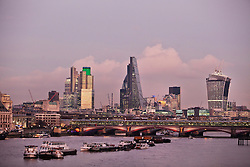 © Licensed to London News Pictures. 09/12/2013. London, United Kingdom. The skyscrapers and the London Bridge seen from Waterloo Bridge during the sunset. Photo credit : Andrea Baldo/LNP
