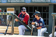 Minnesota Twins manager Ron Gardenhire and Twins DH Joe Mauer talk in the dugout during a game against the Cleveland Indians at Target Field in Minneapolis, Minnesota on July 29, 2012.  The Twins defeated the Indians 5 to 1.  © 2012 Ben Krause