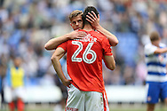 Martin Cranie of Huddersfield Town hugs Christopher Schindler of Huddersfield Town after the final whistle. EFL Skybet  championship match, Reading  v Huddersfield Town at The Madejski Stadium in Reading, Berkshire on Saturday 24th September 2016.<br /> pic by John Patrick Fletcher, Andrew Orchard sports photography.