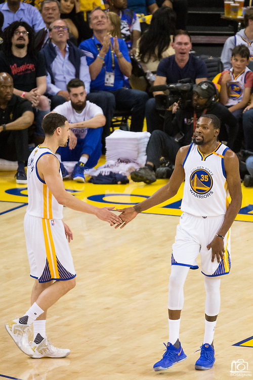 Golden State Warriors forward Kevin Durant (35) and Golden State Warriors guard Klay Thompson (11) celebrate a basket against the Cleveland Cavaliers during Game 5 of the NBA Finals at Oracle Arena in Oakland, Calif., on June 12, 2017. (Stan Olszewski/Special to S.F. Examiner)