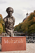 Statue of writer Multatuli  in Torensluis square along the  Singel canal in Amsterdam.