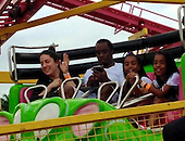 P Diddy Enjoys His Phone While riding at The Fair