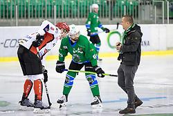 Andrej Tavzelj of HDD SIJ Acroni Jesenice and Andrej Hebar of HK SZ Olimpija with Ziga Foedransperg - Fedr during ice hockey match between HK SZ Olimpija and HDD SIJ Acroni Jesenice in AHL - Alps Hockey League 2017/18, on October 25, 2017 in Hala Tivoli, Ljubljana, Slovenia. Photo by Matic Klansek Velej / Sportida