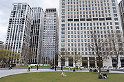 People hanging out at the Jubillee Park and Garden on the South Bank in the shadow of new apartment buildings and the refurbished Shell Centre on 13th April 2021 in London, United Kingdom. The South Bank is a significant arts and entertainment district, and home to an endless list of activities for Londoners, visitors and tourists alike.