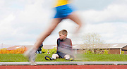 Meath Athletics track & field championships at Claremount stadium 16th May 2010<br /> Young Na Fianna athlete, Mark Daly looks on as the mens 3000m race takes place <br /> Photo: David Mullen / www.cyberimages.net