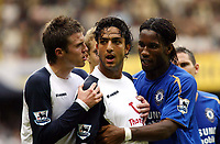 Fotball<br /> England 2005/2006<br /> Foto: SBI/Digitalsport<br /> NORWAY ONLY<br /> <br /> Tottenham v Chelsea<br /> The Barlcays Premiership.<br /> 27/08/2005.<br /> Michael Carrick of Spurs and Didier Drogba try to persuade Mido to leave the pitch after being sent off