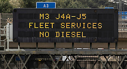 © Licensed to London News Pictures. 28/09/2021. Cobham, UK. A matrix sign warns drivers on the M25 near Cobham in Surrey that Fleet Service Station on the M3 has no diesel. The government have urged drivers not to panic buy fuel. Photo credit: Peter Macdiarmid/LNP