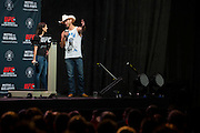 """DALLAS, TX - MARCH 13:  Megan Olivi and Donald """"Cowboy"""" Cerrone answer fan questions before the UFC 185 weigh-ins at the Kay Bailey Hutchison Convention Center on March 13, 2015 in Dallas, Texas. (Photo by Cooper Neill/Zuffa LLC/Zuffa LLC via Getty Images) *** Local Caption *** Megan Olivi; Donald Cerrone"""