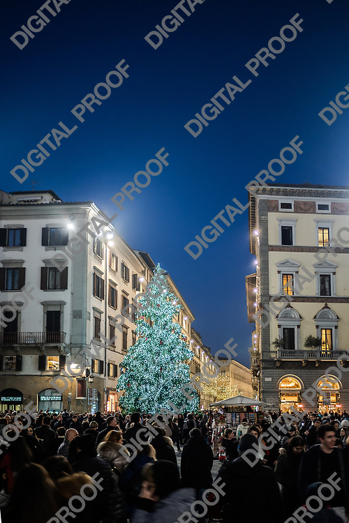Firenze, Tuscany Italy - December 30, 2018 Florence Christmas Tree Lights with tourist crowd