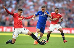 Manchester United's Chris Smalling (left) and Chelsea's Eden Hazard battle for the ball