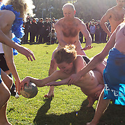 Rachel Scott, 21, from Dunedin scores a try for the 'Nude Blacks' during  the 'Nude Blacks' versus a Fijian invitation side played at Logan Park, Dunedin as an unofficial curtain raiser match before the New Zealand V Fiji test match in Dunedin, New Zealand...The 'Nude Blacks' won the match 20-10 with 21 year old female player Rachel Scott, a member of the Otago women's rugby team named player of the day. .Over 500 people turned up to watch the match which included a blind referee, Julie Woods and three clothed streakers who were ejected from the playing area..The 'Nude Blacks' traditionally play games before test matches in Dunedin and were using this match as a warm up for three nude games planned during the IRB Rugby World Cup in New Zealand with teams from Argentina, Italy, England and Ireland involved.  Matches will be played before World Cup games in Dunedin. New Zealand. 22nd July 2011. Photo Tim Clayton