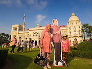 10 JANUARY 2015 - BANGKOK, THAILAND: A woman and her son pose with a life sized cardboard cutout of General Prayuth Chan-ocha, the Prime Minister of Thailand during Children's Day festivities at Government House. National Children's Day falls on the second Saturday of the year. Thai government agencies sponsor child friendly events and the military usually opens army bases to children, who come to play on tanks and artillery pieces. This year Thai Prime Minister General Prayuth Chan-ocha, hosted several events at Government House, the Prime Minister's office.    PHOTO BY JACK KURTZ