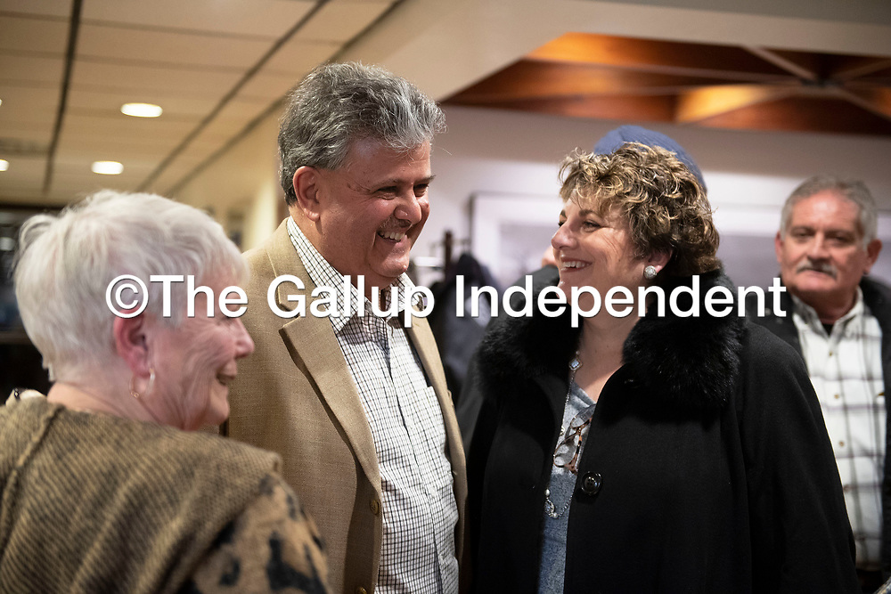 Mayoral candidate Sammy Chioda and his wife Marie talk with community members at City Hall after final election results were posted Tuesday night in Gallup. Chioda led with 39.59% of the vote followed by 29.01% for Louis Bonaguidi. Chioda and Bonaguidi will have to participate in a runoff election.