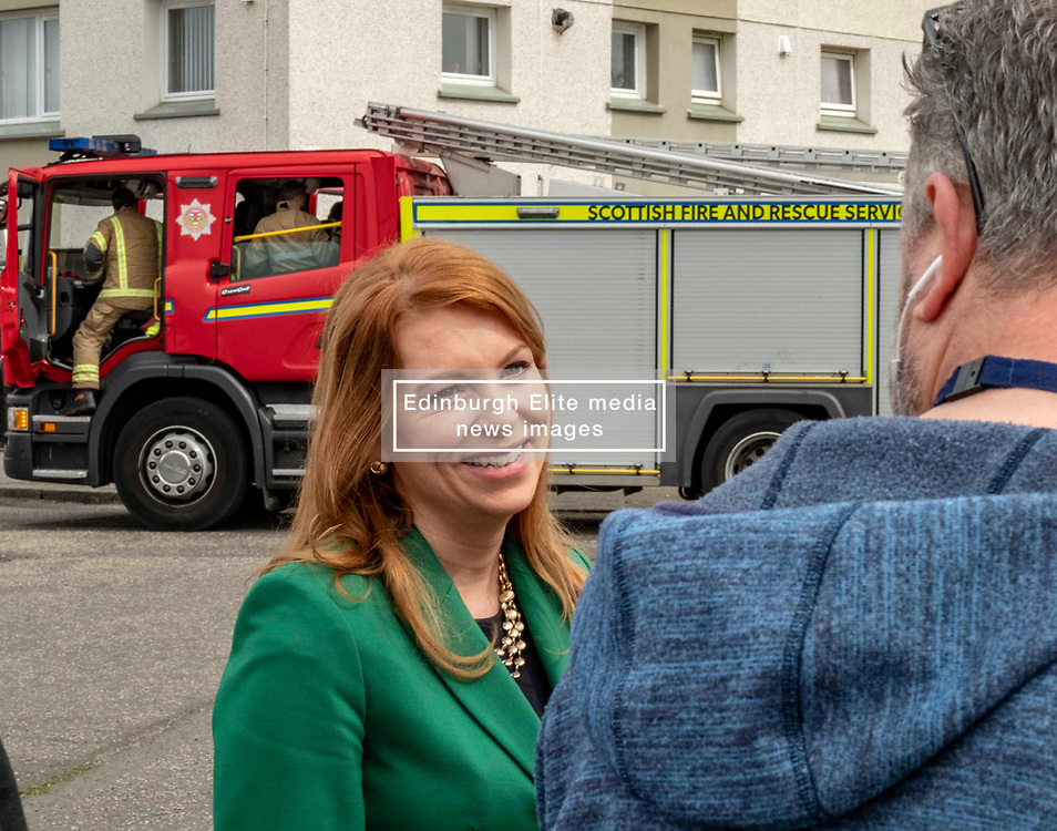 EMBARGOED UNTIL 00:01 24 April 2019<br />Pictured: The fire engine and crew had to leave on a shout as Ash Denham was being interviewed.<br /><br />Today, Community Safety minister Ash Denham launched the Scottish Government's consultation on Strengthening Fire Safety for High Rise Domestic Buildings following the Grenfell Tower fire in London.  Ms Denholm was joined by Assistant Chief Fire Officer Ross Haggart and Mark McHale, building manager of Wauchope House, <br /><br /><br />Ger Harley | EEm 23 April 2019
