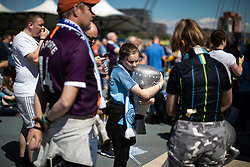 © Licensed to London News Pictures . 12/05/2019. Manchestr , UK . Manchester City supporters watch the club's Premier League match at Brighton on a big screen in City Square at the Etihad Stadium. If Manchester City win the match they will win the title for the second time in a row . Photo credit : Joel Goodman/LNP