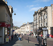 Shops and shoppers in the High Street of the town of Chippenham, Wiltshire, England