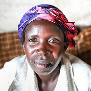 CAPTION: 70% of rural Uganda's women are illiterate, which frequently renders them powerless. 39-year-old Florence enrolled onto an adult literacy program run by World Renew's partner organization, the Kaberamaido Development Mission. LOCATION: Apapai Parish, Otuboi Sub-county, Kalaki County, Kaberamaido District, Uganda. INDIVIDUAL(S) PHOTOGRAPHED: Florence Agabo.