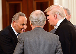 United States President Donald Trump, right, welcomes US Senate Minority Leader Chuck Schumer (Democrat of New York), right, and US Senate Majority Leader Mitch McConnell (Republican of Kentucky), center as he hosts a reception for US House and US Senate Republican and Democratic leaders in the State Dining Room of the White House in Washington, DC, USA, on Monday, January 23, 2017. Photo by Ron Sachs/CNP/ABACAPRESS.COM