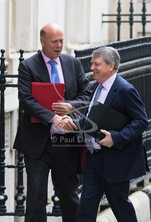 Downing Street, London, June 16th 2015. Leader of the House of Commons Chris Grayling arrives at 10 Downing Street for the weekly cabinet meeting, accompanied by political strategist Lynton Crosby.