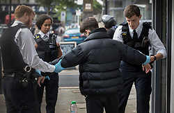 FILE IMAGE © Licensed to London News Pictures. 25/05/2018. London, UK. Police detain and search a youth during a gang patrol in Islington. Photo credit: Peter Macdiarmid