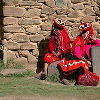 South America, Latin America, Peru, Urubamba Valley. Quechua Women rest in the sun in Ollantaytambo.